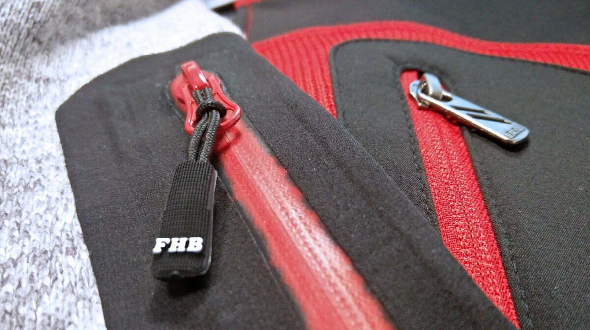 Détails des poches imperméables de la polaire FHB et de la veste Blaklader